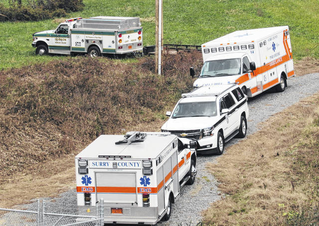 Emergency and law enforcement crews are seen working the scene where a deceased man was found off U.S. 21 in Elkin Saturday morning between Poplar Springs ...