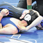 Elks advance to second round of NCHSAA Dual Team Tournament before bowing to Ironmen