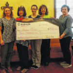 Grace Clinic receives gift from WoodmenLife