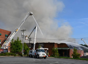 Updated: Blaze engulfs downtown factory, injures one